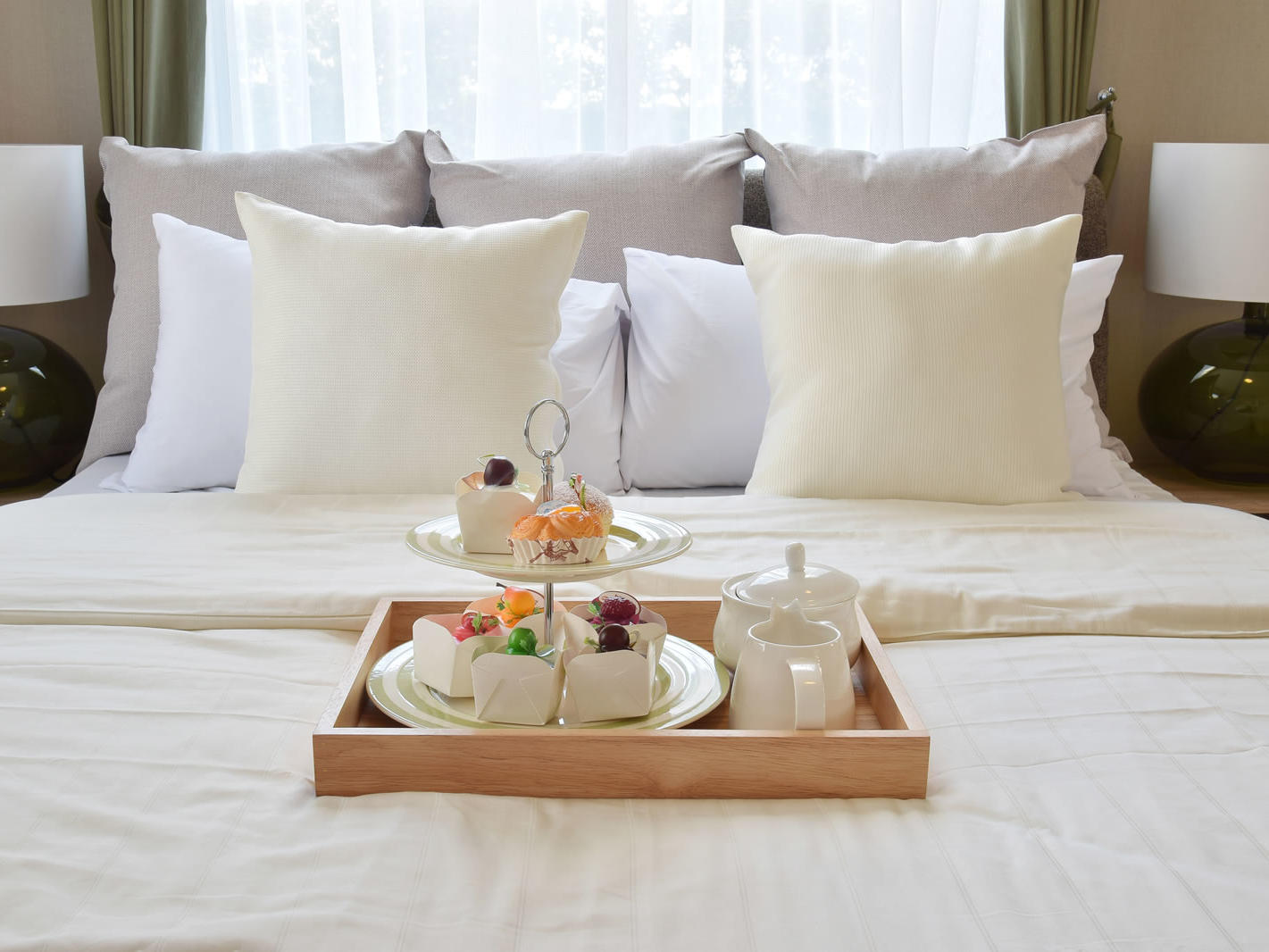 tea and cakes tray on bed Unahotels Palazzo Mannaioni Toscana