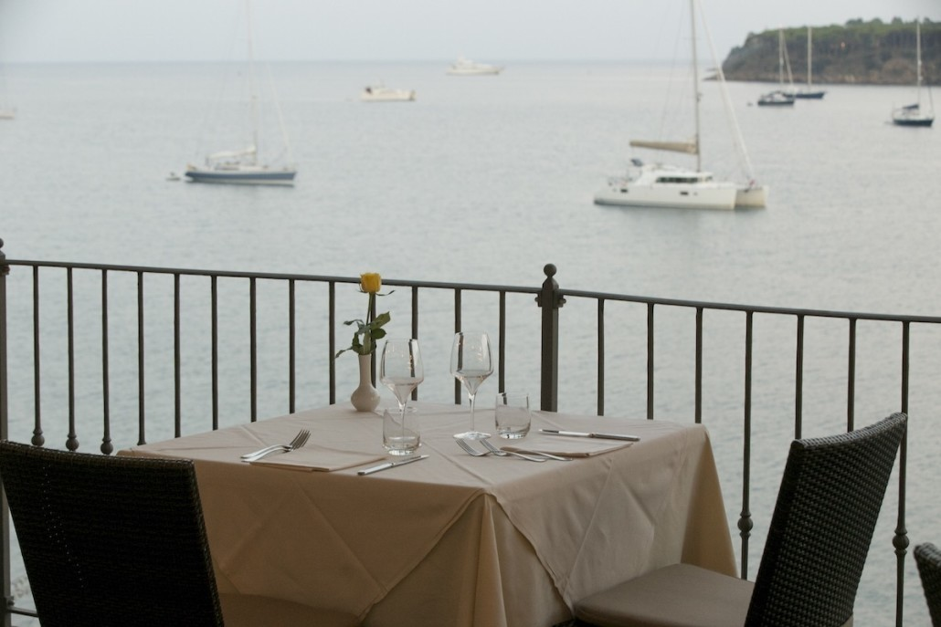 Laid table and chairs overlooking the harbour