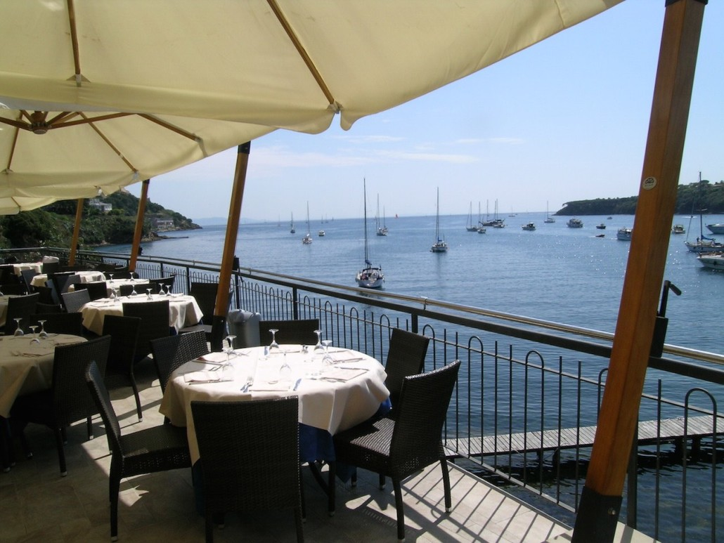 Outdoor dining area with a view of the harbour