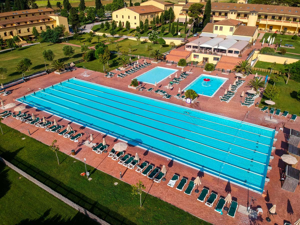arial view of swimming pools with poolside sun loungers