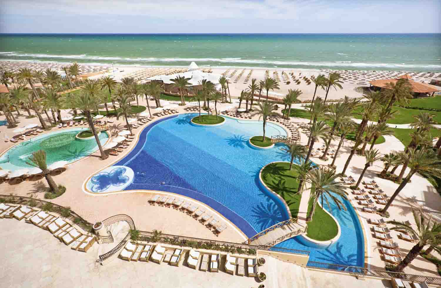 Movenpick Resort and Marine Spa Overlooking Pool and Beach
