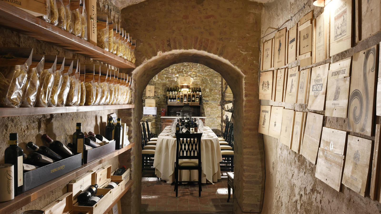 wine cellar with arched doorway Unahotels Palazzo Mannaioni Toscana