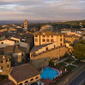 ariel view of the hotel and surrounding town Unahotels Palazzo Mannaioni Toscana