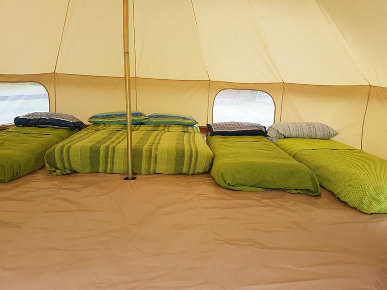 beds inside of a tent Le Selvole Farmhouse