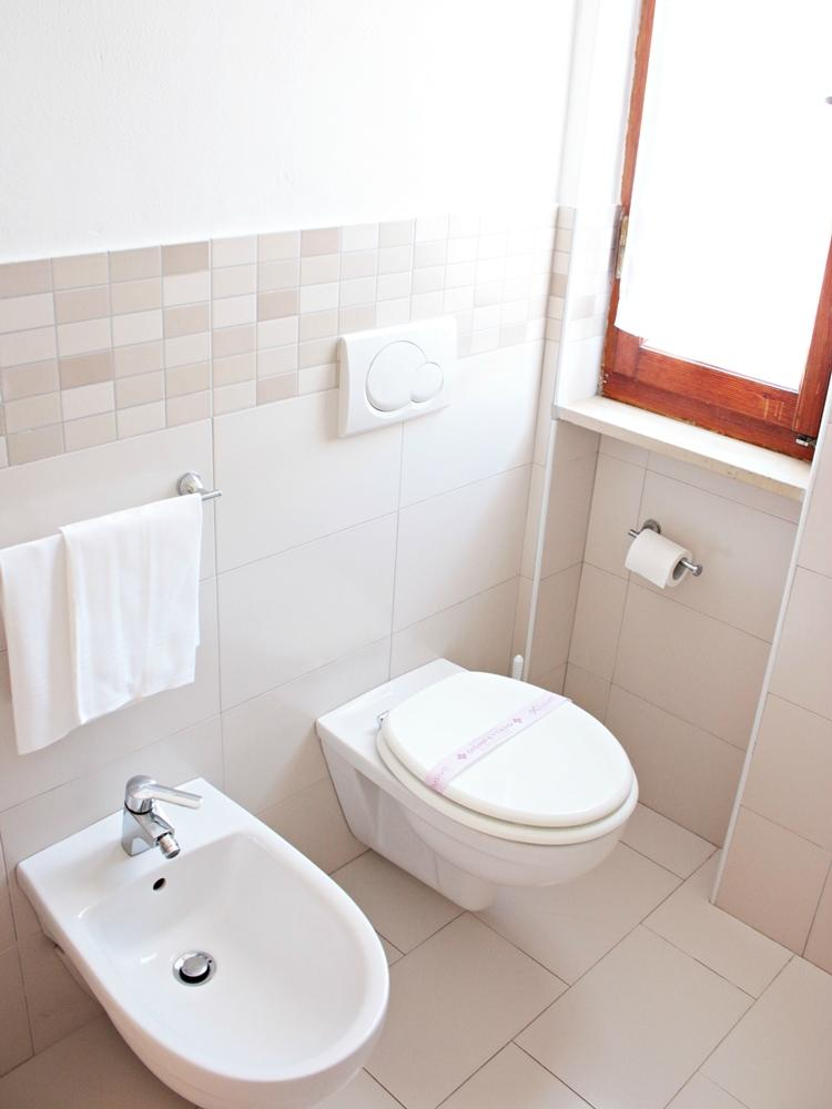 Bathroom with bidet and toilet