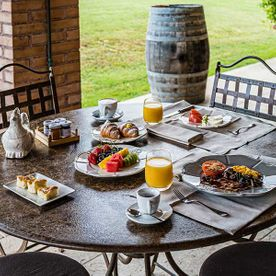 outdoor table and chairs with breakfast foods