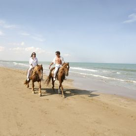 The Residence Tunis Beach Couple Riding Horses
